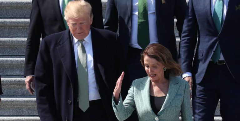 FILE PHOTO: U.S. President Donald Trump walks down the U.S Capitol steps with Speaker of the House Nancy Pelosi (D-CA) after they both attended the 37th annual Friends of Ireland luncheon at the U.S. Capitol in Washington, U.S., March 14, 2019. REUTERS/Jonathan Ernst